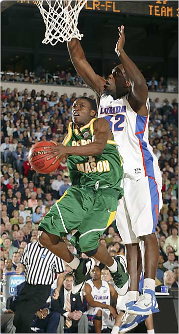 Tony Skinn drives to the hoop against the Gators in the first of Saturday's games in Indianapolis