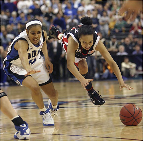 Kristi Toliver (right) drained a three-pointer with 6.1 seconds left in regulation to force overtime as Maryland outlasted Duke in overtime 78-75 to win its first women's basketball national championship.