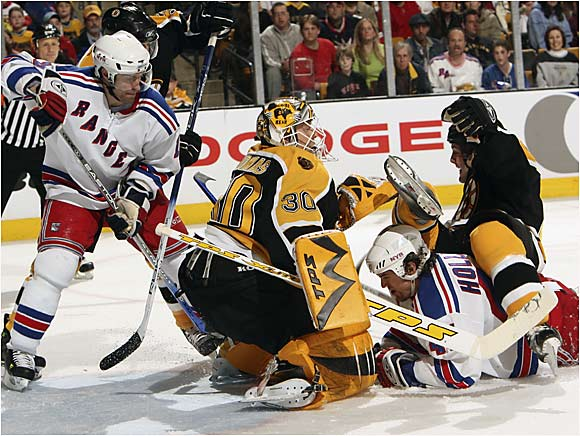 Several Rangers collided with Bruins goalie Tim Thomas as New York eked out a 4-3 overtime victory at the TD Banknorth Garden.