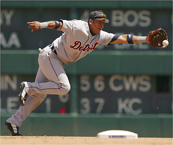 Carlos Guillen stretches out for a ground ball against the Rangers in Arlington. The Tigers' 5-3 loss on Sunday was their first of the season.