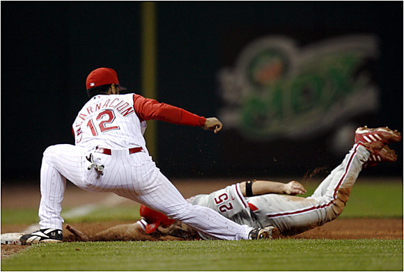 David Bell slid under the tag of Reds third baseman Edwin Encarnacion during an 8-4 Phillies victory on Friday in Cincinnati.
