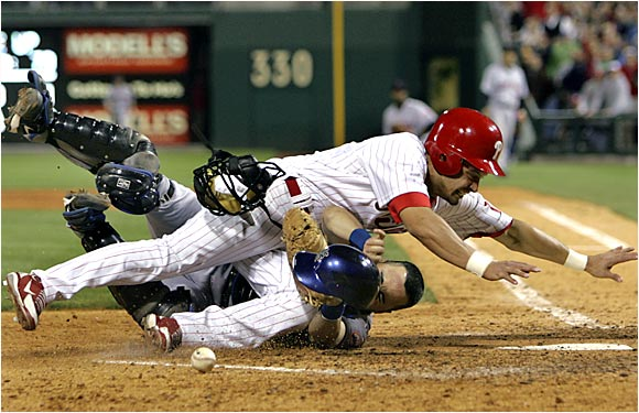 Outfielder Shane Victorino bulldozed catcher Paul Lo Duca and scored a key eighth-inning run in the Phillies' 5-4 victory over the Mets last Tuesday in Philadelphia.