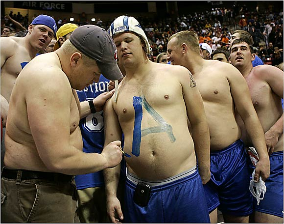 Air Force fans apply war paint before the Falcons' game against Illinois in the NCAA Tournament.