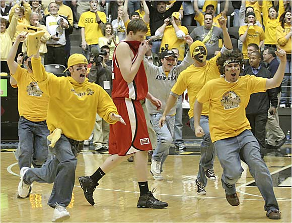 Wichita State fans rush the floor after beating Illinois State, 64-57, in the MVC title game.