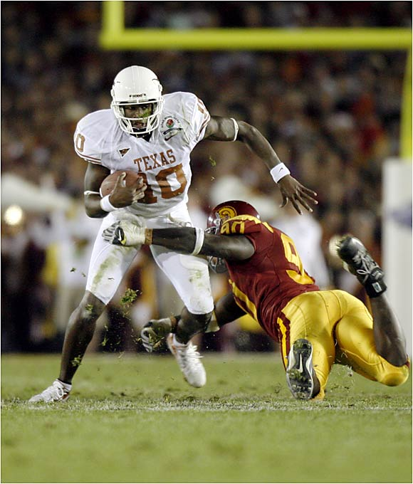 "Vince Young uses his ""swivel hips"" to avoid a USC tackler in the Longhorns' Rose Bowl win."
