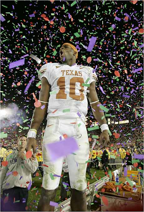 Young soaks it all in as confetti rains down.
