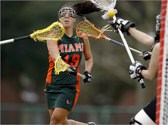 A Miami attacker avoids the defense and fires a shot past the goalie.