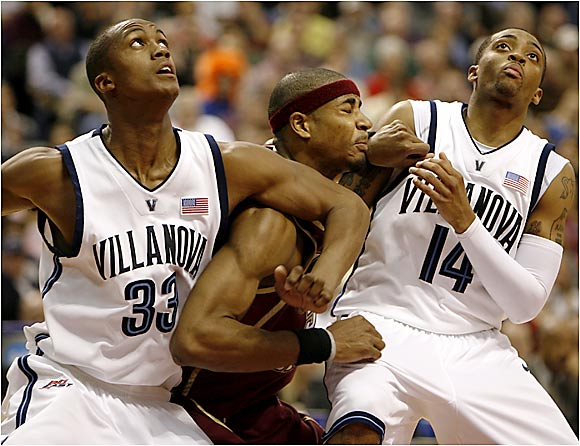 Dante Cunningham and Allen Ray create a rebounding sandwich against BC.