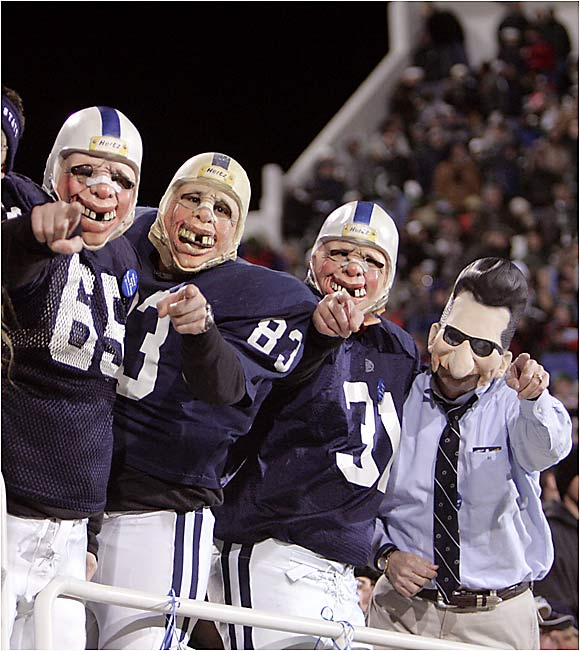 Penn State fans dress up in football uniforms and Joe Paterno masks during a game against Michigan State last November.