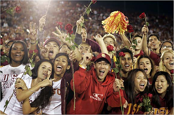 USC fans hold roses while celebrating the Trojans' victory over crosstown rival UCLA.