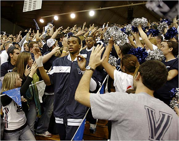 Villanova players run onto the court through the student section before a regular-season game against Oklahoma.