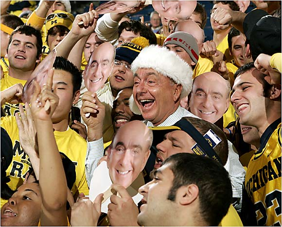 ESPN analyst Dick Vitale hangs out with Michigan fans before the Wolverines' game against UCLA last December.