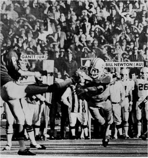 Alabama was up 16-3 and only five minutes away from a 11-0 start and a chance to play for the national championship. But Auburn's Bill Newton blocked a punt, which bounced to teammate David Langner who took it for a 25-yard touchdown with 5:30 remaining. Auburn held on defense and with three minutes remaining and forced Alabama to punt. Once again, Newton blocked the kick, Langner picked it up and ran for the score, giving the Tigers a 17-16 win.