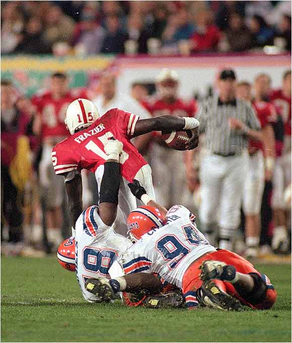 "In the Cornhuskers 62-24 Fiesta Bowl win, QB Tommie Frazier left several Gators in his tracks for an amazing 75-yard touchdown run. ""How many tackles can one make break?"" exclaims the announcer."