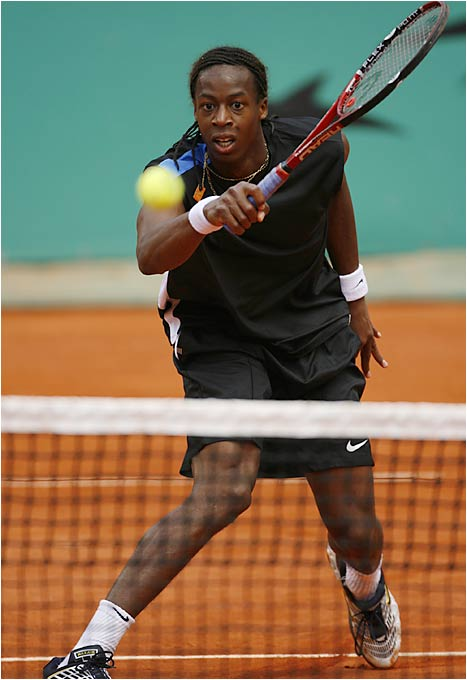 Gael Monfils (left) won a battle of 19-year-olds, outlasting Andy Murray 6-4, 6-7, 1-6, 6-2, 6-1.