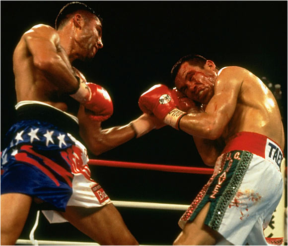 "Just 23 and with a record of 22-0, De La Hoya was defending his WBC super lightweight title against his boyhood hero Chavez, who at 33 was a Mexican legend, a multiple world champ and veteran of 99 fights. Unfazed by the pro-Chavez crowd at Caesars Palace in Las Vegas, the kid sliced the old lion to ribbons in four cruel, bloody rounds. Said a humble De La Hoya afterward, ""I need many more fights to learn, many more years to become a complete champion."""