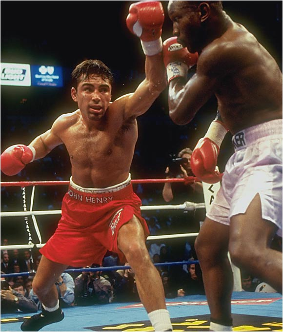 """His style is the most difficult in boxing,"" said De La Hoya, in reference to the southpaw wizardry of Whitaker, 33, the WBC welterweight champ and, pound for pound, the best boxer in the world. In a cat-and-mouse fight that was probably closer than the judges' scorecards had it, De La Hoya -- in his first outing at 147 pounds -- emerged with a 12-round decision and a serious dose of experience."