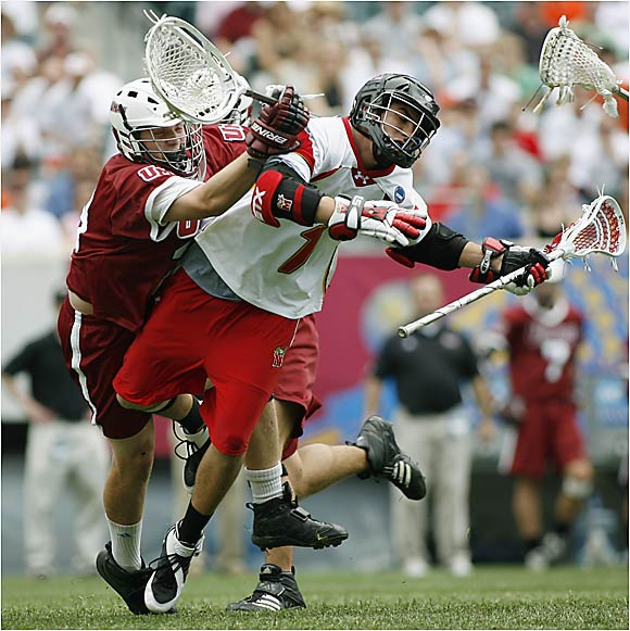 UMass relied on its aggressive defense and the outstanding play of freshman goalkeeper Doc Schneider (left) to upset the heavily favored Terps 8-5 and advance to its first men's lacrosse championship. The Minutemen shut down Maryland's All-America attackman Joe Walters (1), the leading active scorer in Division I (227 career points).