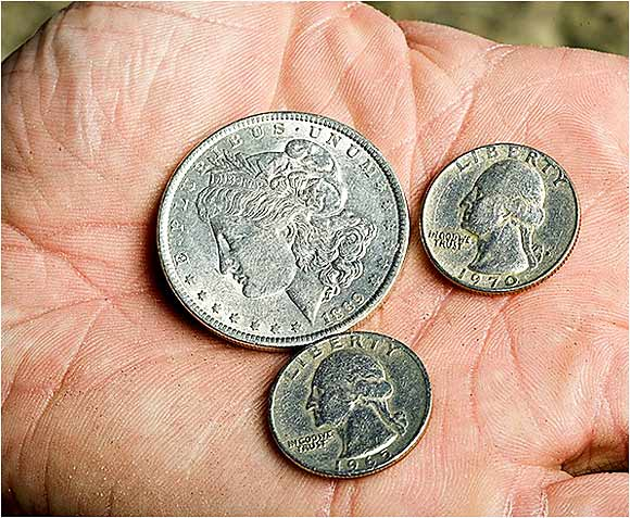 An 1889 silver dollar and quarters dated with the years that he (1965) and wife Jennifer (1970) were born.