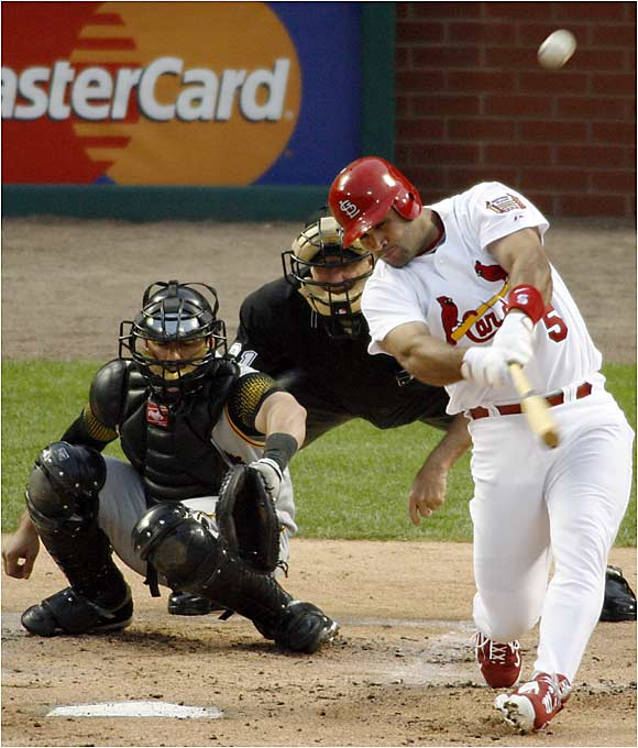 Cardinals slugger Albert Pujols set the record for most home runs in April with 14, including this blast against the Pirates on April 24.