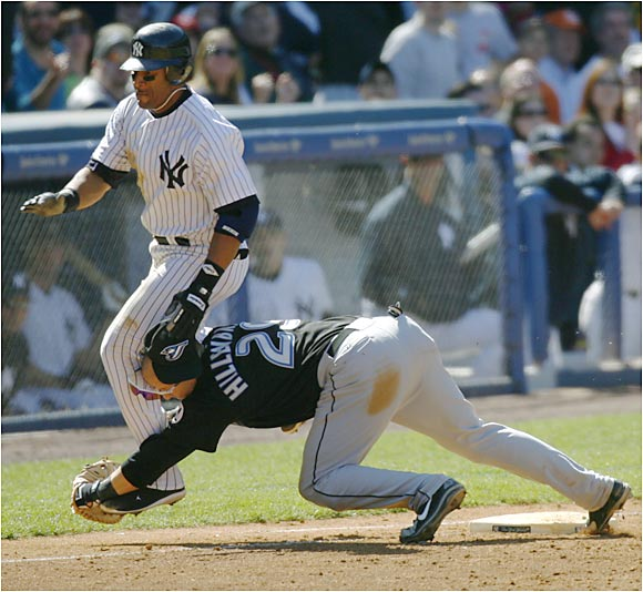 The Yankees' Gary Sheffield had to leave the game after this collision with Blue Jays first baseman Shea Hillenbrand on Saturday in the Bronx.