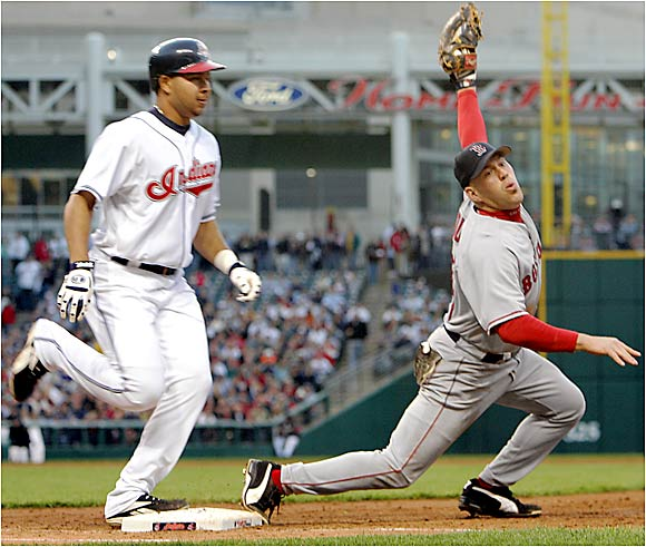 Boston's Kevin Youkilis stretches, but Cleveland's Jhonny Peralta beats the throw to first base at Jacobs Field on Thursday.