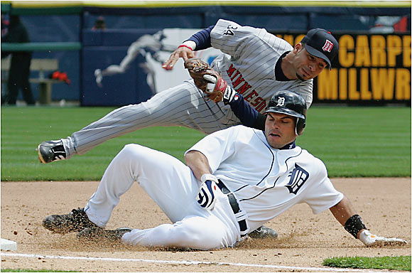 Catcher Ivan Rodriguez was tagged out at third base by the Twins' Juan Castro, but the Tigers went on to win their seventh straight game last Thursday at Comerica Park. The last time the Tigers won seven in a row was 1993.