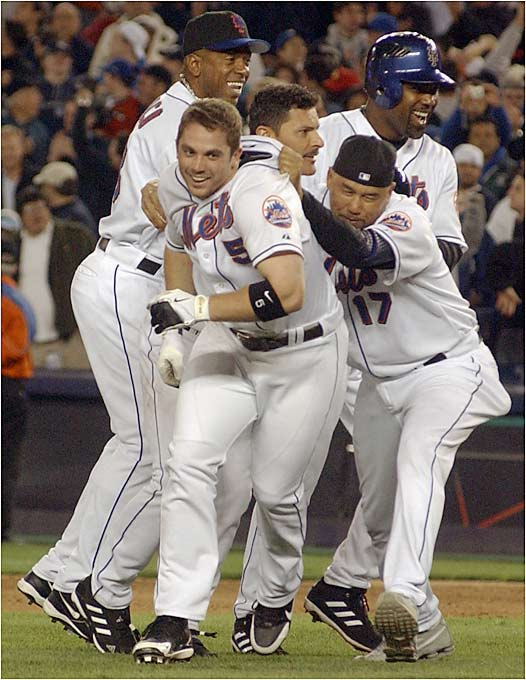 David Wright is mobbed by his teammates after hitting a game-winning single over the head of Yankees center fielder Johnny Damon on Friday. Wright's heroics came with two outs in the bottom of the ninth against Mariano Rivera, and capped a four-run comeback for the Mets at Shea Stadium.