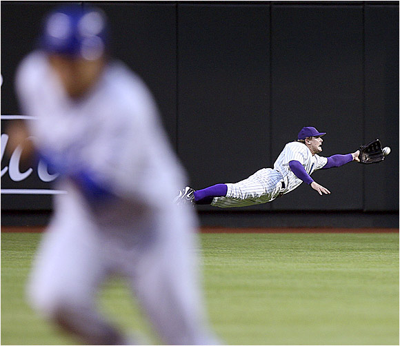 D'backs center fielder Eric Byrnes fails to make this diving catch on a ball hit by the Dodgers' Kenny Lofton in Phoenix last Tuesday.