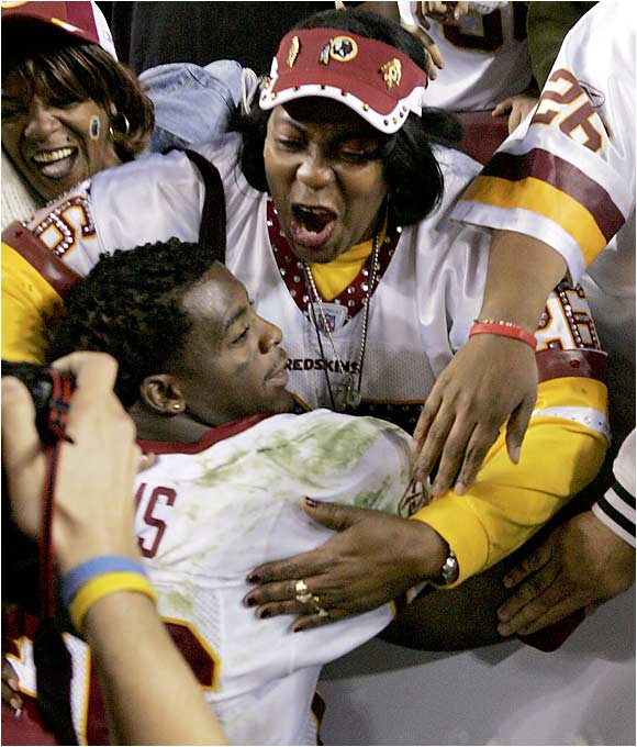 Redskins running back Clinton Portis celebrates with his mother, Rhonnel Hearn, after Washington beat Philadelphia 17-10. Portis famously took his mother to his senior prom at Gainesville (Fla.) High in 1999.