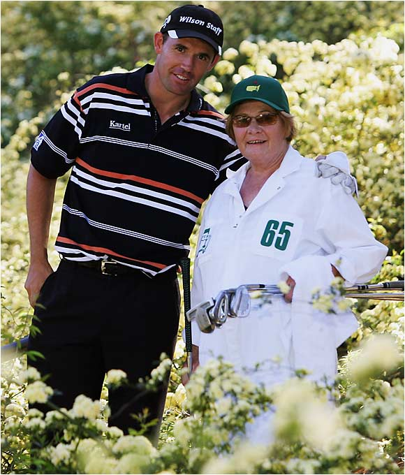 Irish golfer Padraig Harrington poses with his mother, Breda, who caddied for him during a par-3 contest prior to the Masters.