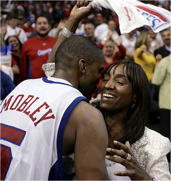 Clippers guard Cuttino Mobley hugs his mother, Jackie, after a 101-83 win over the Denver Nuggets in Game 5 of the playoffs' first round. The victory gave Los Angeles its first playoff series win in 30 years.