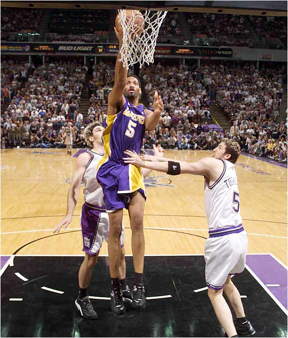 A week after stunning the Sacramento Kings with a Game 4-ending 3-pointer to complete a Lakers comeback from a 20-point fourth quarter hole, Robert Horry helped L.A. finish off their upstate rivals with a 112-106 overtime victory in Sacramento.