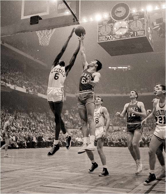 Led by a rookie center out of San Francisco named Bill Russell and his 19 points and 32 rebounds, the Celtics fought off the St. Louis Hawks in double overtime 125-123 for their first NBA crown. Helping Russell was fellow rookie Tom Heinsohn with 37 points and 23 rebounds, which offset a combined 5-for-40 shooting performance by Boston stars Bob Cousy and Bill Sharman.
