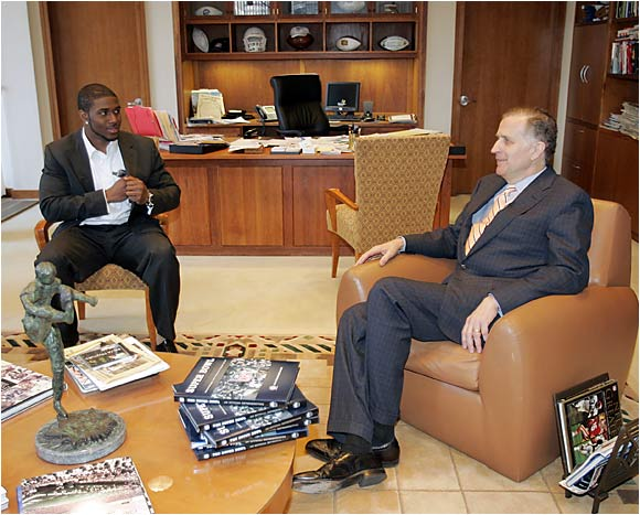 Outgoing NFL commissioner Paul Tagliabue shares some time in his office with USC running back and Heisman Trophy winner Reggie Bush.