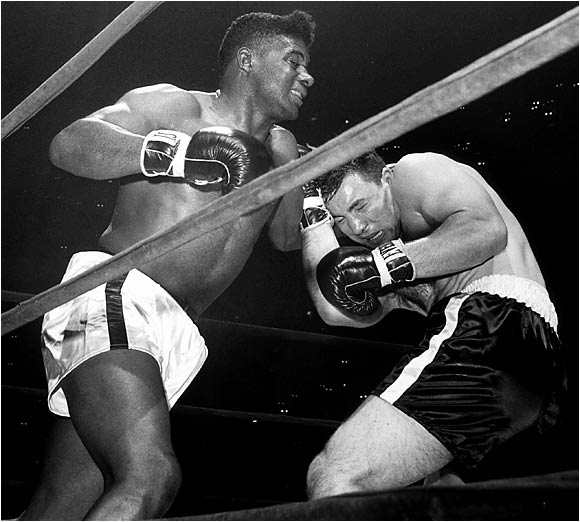 Patterson had gone into hiding after his first loss to Liston, and when he lasted just four seconds longer in a rematch the following year, it seemed his career might well be over. But, since his impoverished childhood in Brooklyn, Patterson had been a survivor, and he fought on, winning three bouts overseas before returning to the spotlight in New York City's Madison Square Garden against rugged Canadian contender George Chuvalo. Fighting with a broken left hand, Patterson used his speed and superior skill to gut out a unanimous decision win.