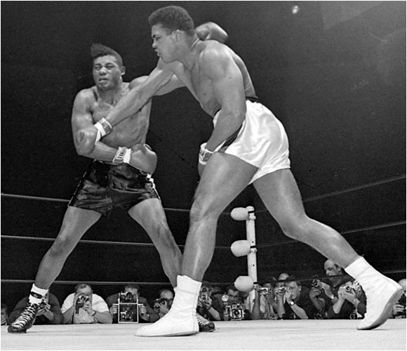 "His win over Chuvalo earned Patterson a shot at Muhammad Ali, who had taken the heavyweight title from Liston in 1964. The bout, on Nov. 22, 1965, in the Convention Center in Las Vegas, was an ugly moment in the sport. Patterson, boxing with a slipped disc in his back, was no match for the champion, and Ali, angered by Patterson's insistence on referring to him as ""Clay,"" punished and taunted him throughout. The fight was finally stopped in the 12th round. Afterward, Ali insisted he had not been trying to prolong Patterson's agony. ""He took my best punches,"" said Ali. ""He just wouldn't go down."""
