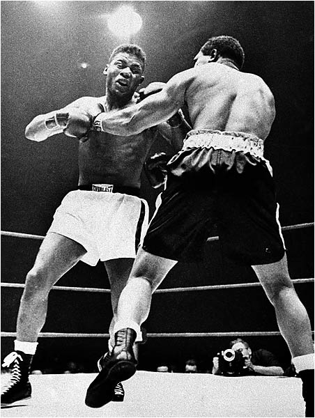 Call this one a battle of the ages. Patterson, who had turned pro after winning the middleweight gold medal in the 1952 Olympics, was just 21 when he faced Archie Moore, 42, for the heavyweight title vacated by Rocky Marciano. On Nov. 30, 1956, in Chicago Stadium, Patterson knocked out the Old Mongoose in five rounds to become the youngest heavyweight champion in history.