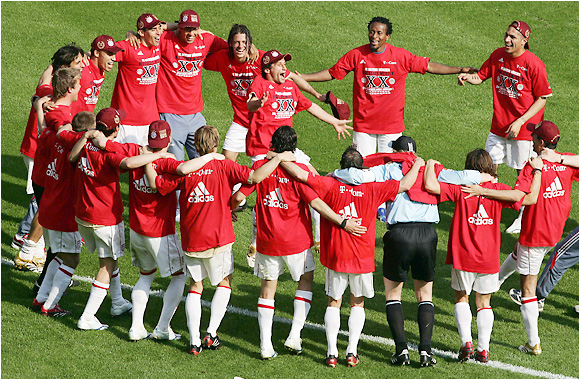 "Bayern Munich players celebrate the 20th Bundesliga title in club history. The Bavarians also won the German Cup, the unprecedented second straight year in which they accomplished the ""double."""
