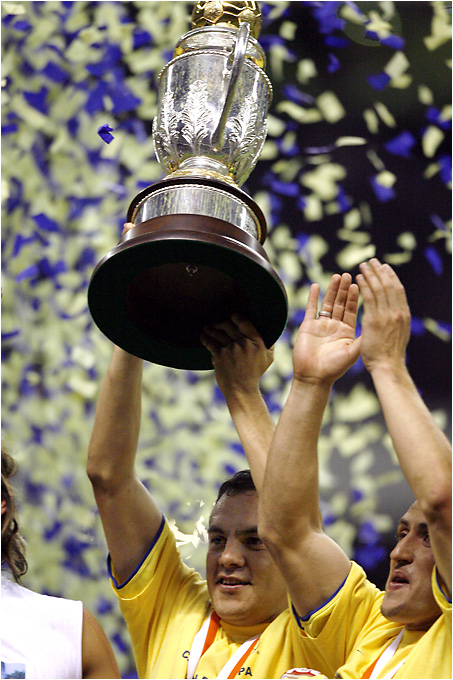 Club América star Cuauhtémoc Blano hoists the CONCACAF Champions Cup after his team beat Toluca in the tournament final. The Águilas didn't qualify for the Mexican playoffs, but their regional title means they'll represent the entire confederation in December's FIFA Club World Championship.