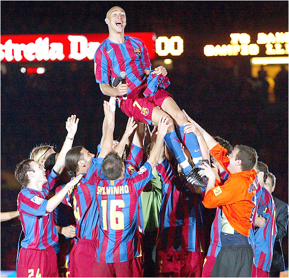 Barcelona players hoist Swede Henrik Larsson into the air in celebration of their 18th Spanish-league title and second straight crown. Barça will go for the European title as well on May 17 when it meets Arsenal in the Champions League final.