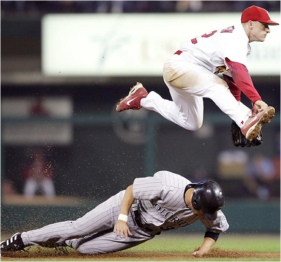 Cardinals shortstop David Eckstein tries to escape after taking care of Rockies' Cory Sullivan.