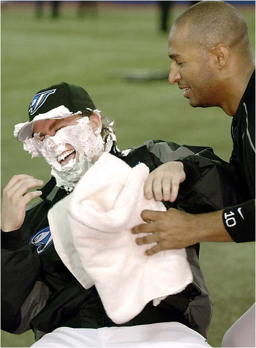 "The Blue Jays' Vernon Wells shows rookie pitcher Casey Janssen that the ""shaving cream pie in the face"" routine never gets old."
