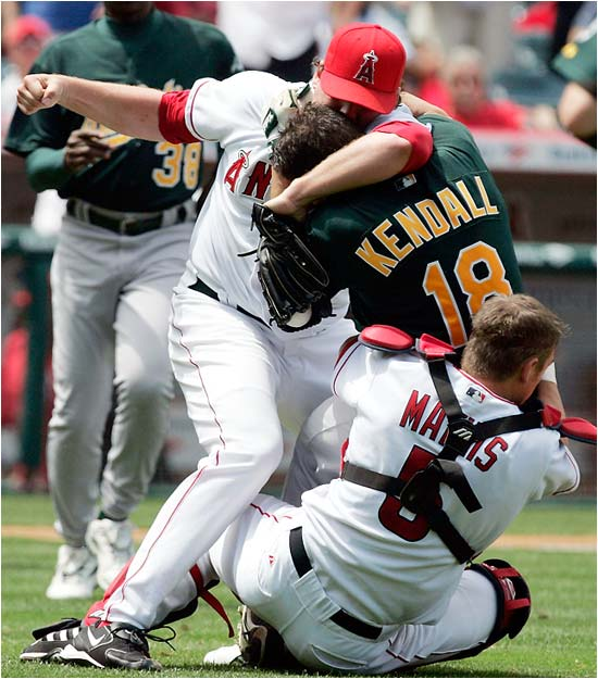 Is Angels pitcher John Lackey trying to land a big right hand on A's catcher Jason Kendall, or is he trying to make out with him?