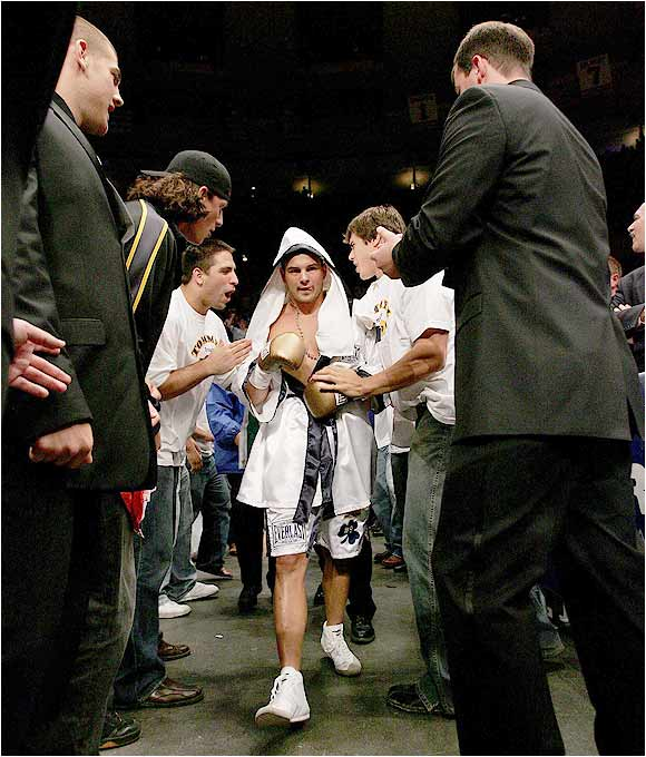 Tom Zbikowski heads to the ring for his first professional boxing match last Saturday night at Madison Square Garden. The fight was attended by over 50 members of Notre Dame's football team including Brady Quinn and Jeff Samardzija, who led their teammate to the ring.