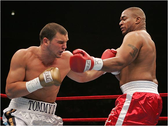 Zbikowski connects with a left hook to his opponent, Robert Bell, during their Heavyweight bout last Saturday.