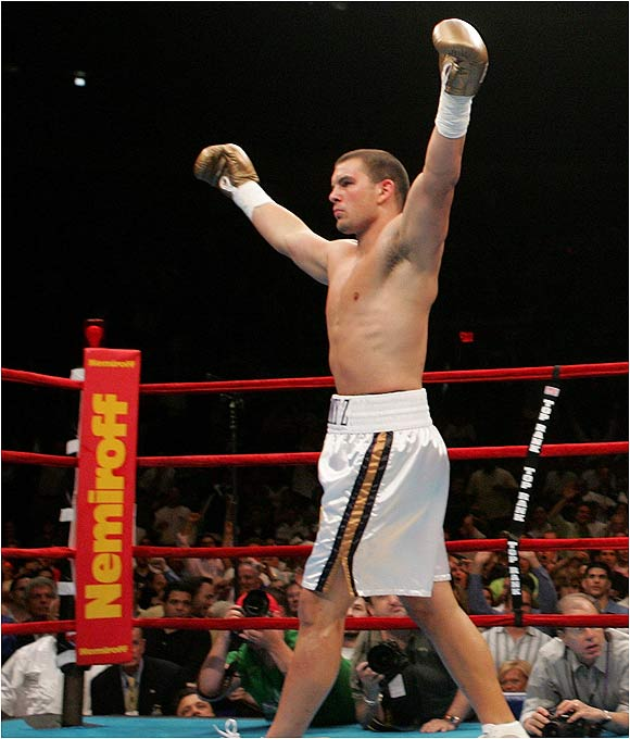 Zbikowski celebrates after winning his professional boxing debut. The 21-year-old Notre Dame receiver earned $25,000 for the fight.