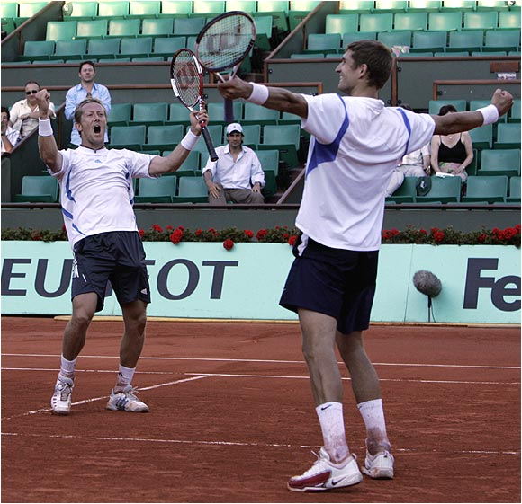 Jonas Bjorkman and Max Mirnyi react after winning their second straight French Open men's doubles title.