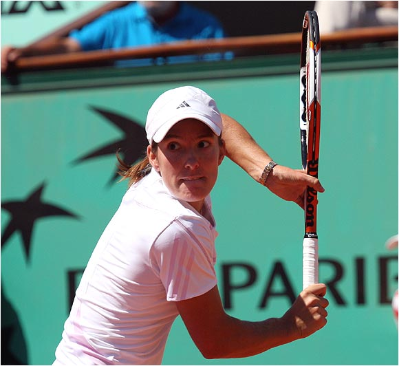 Down 2-0, 30-love in the second set, Justine Henin-Hardenne stayed steady en route to her third French Open title.