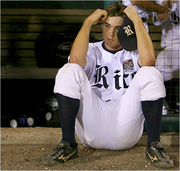 Rice freshman Jimmy Comerota sits dejected after the Owls were eliminated by Oregon State, 2-0. After scoring a run in the fourth inning of its 3-2 in over Miami on Monday, Rice failed to score in a CWS-record 23 consecutive innings. The Owls hit .121 (7-for-58) in the two games against the Beavers.